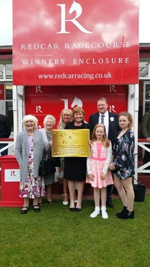 Julie Peary and family with the Golden Ticket at Redcar Racecourse Zetland Gold Cup day