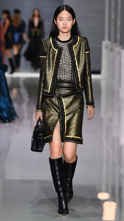 2f6d7310453 For a more dramatic summer tweed go for designer Ralph   Russo s black and  gold laminated tweed box jacket and matching A-line skirt.