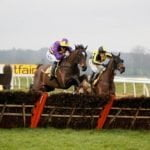 Agrapart (left, ridden by Lizzie Kelly) wins the Betfair Hurdle at Newbury on Super Saturday